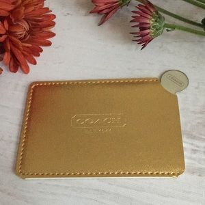 New Coach Mirror w/ Gold Colored Slit Cover & Box.